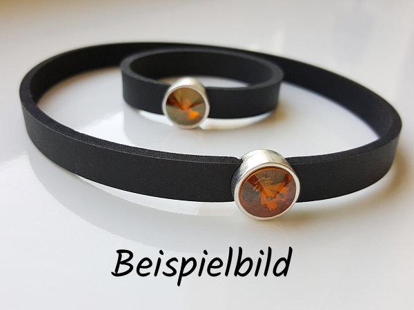 Ein kleines und ein großes Neoprenband, beide mit bernsteinfarbenen Schiebeperlen versehen. Text: Beispielbild.