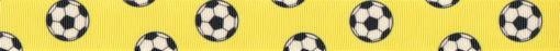 Schwarz-weiße Fußbälle auf gelbem Ripsbanduntergrund.